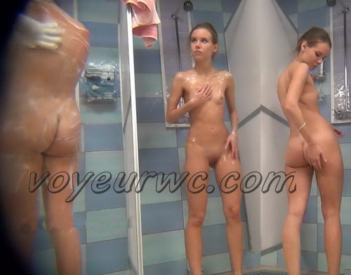 A hidden camera in a public shower films gorgeous women while they soap up their bodies (Hidden Camera Public Shower 152-163)