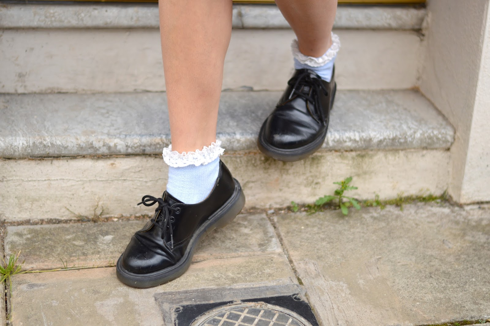 Dr Martens shoes and frilly socks