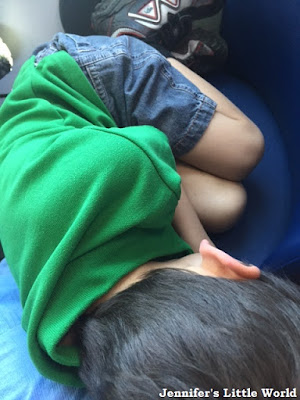 Child sleeping on train after a long day