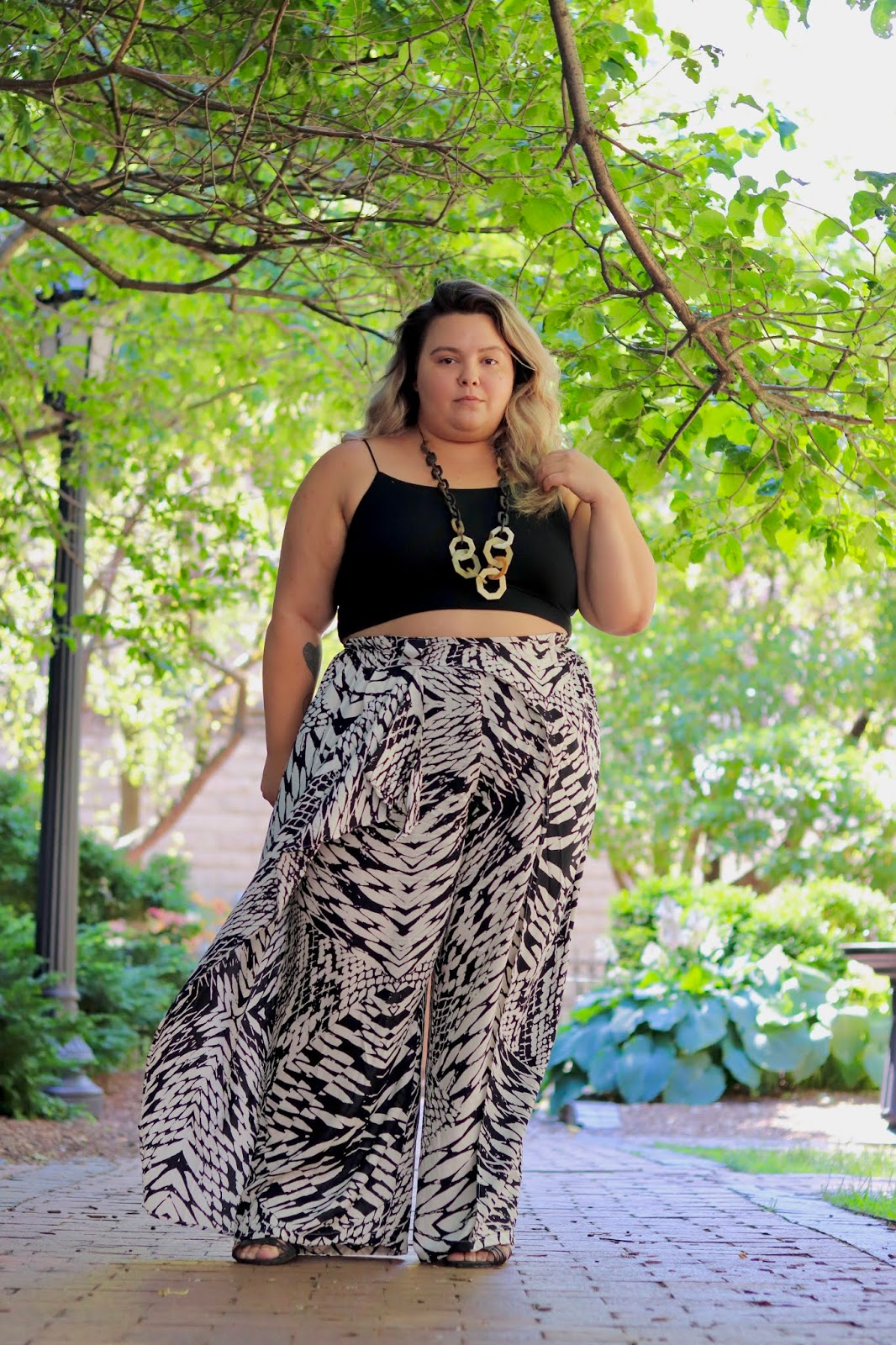 Chicago Plus Size Petite Fashion Blogger, influencer, YouTuber, and model Natalie Craig, of Natalie in the City, reviews Fashion Nova Curves wide leg pants and crop tops. Plus size summer fashion 2019