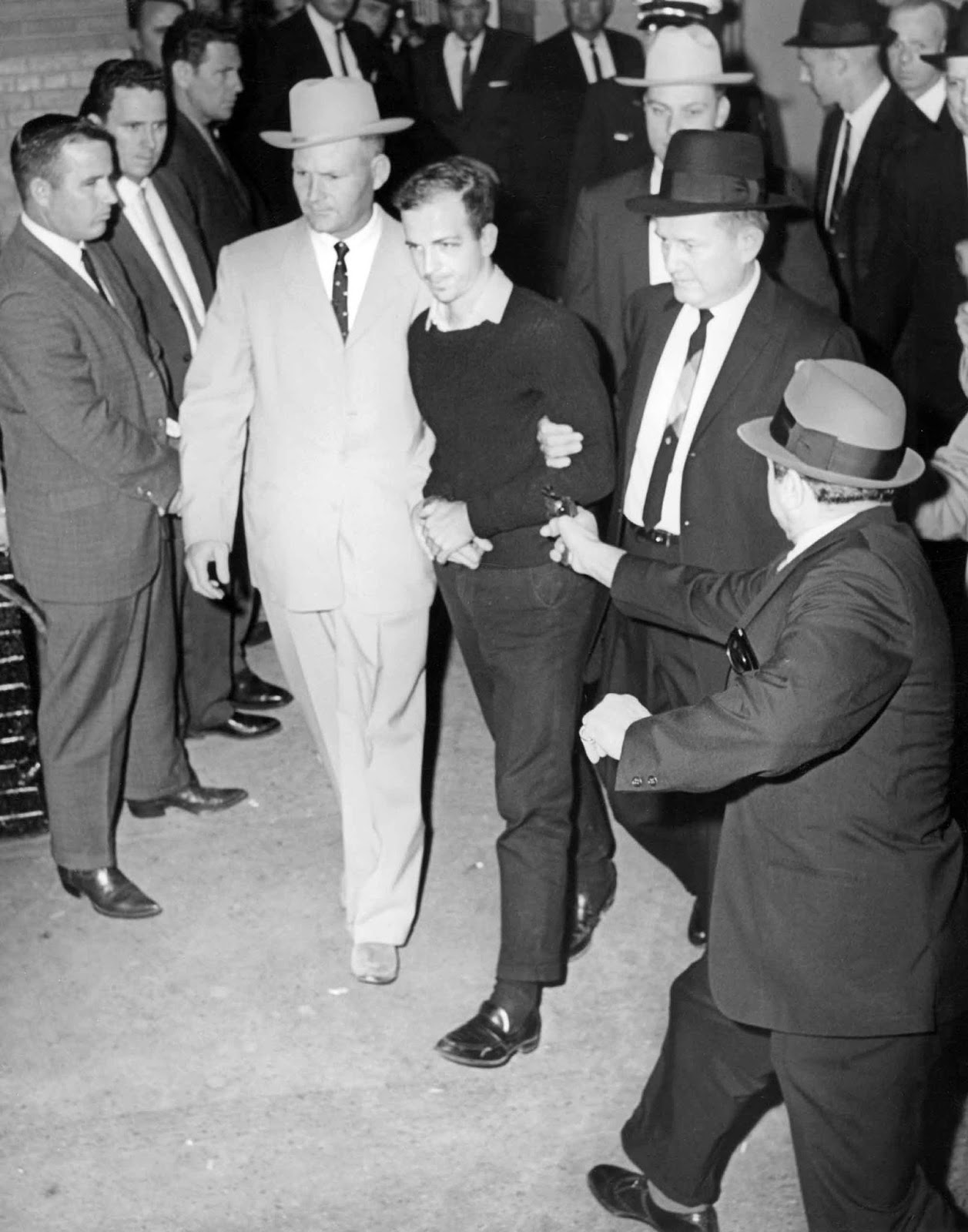 Jack Ruby ready to shoot at Lee Harvey Oswald, as he was escorted to the Dallas city jail via the underground garage of the Dallas police headquarters.