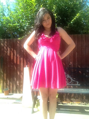 Person wearing a pink dress