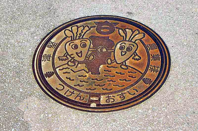 manhole cover, decorated with carrot characters