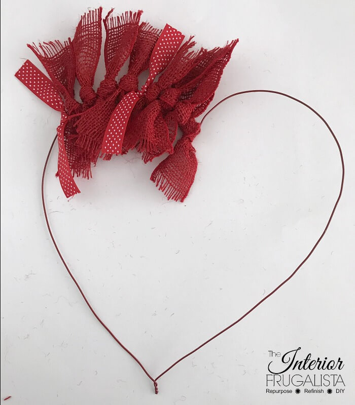 How to make a simple heart-shaped rag wreath for Valentine's Day with red burlap ribbon for a budget-friendly handmade Valentine door wreath idea.