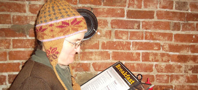 Cynthia M. Parkhill, shown in profile from shoulders up, examines restaurant menu