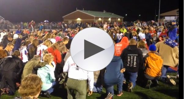 http://www.theblaze.com/stories/2014/10/13/what-led-hundreds-of-kids-parents-and-residents-to-bow-down-and-pray-on-a-high-school-football-field-friday-night/