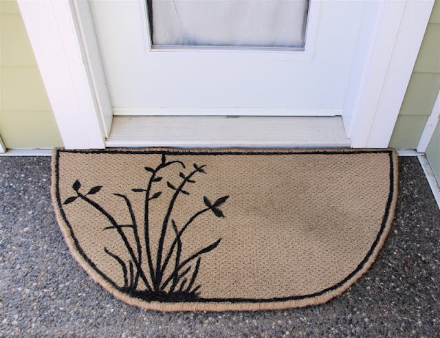 picture of a piece of carpet upcycled into a door mat