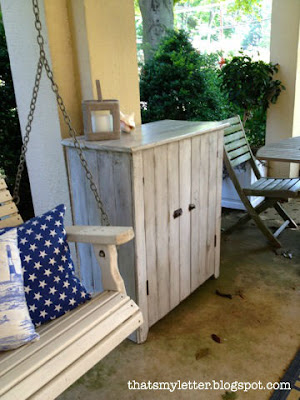 refinished storage cabinet on porch
