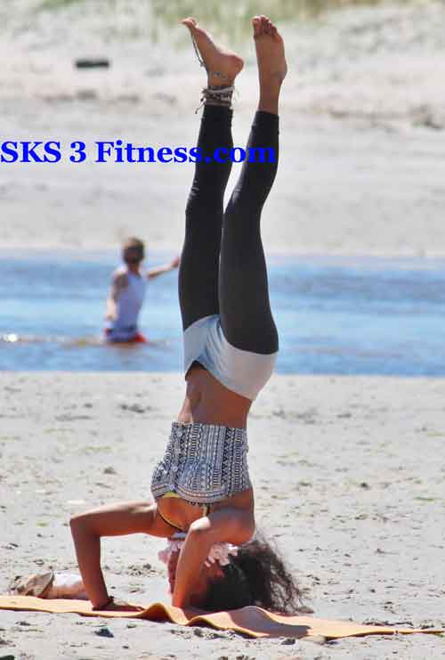 Yoga girl doing Sirsasana | Headstand Pose | Shirshasana Yoga Pose on the beach