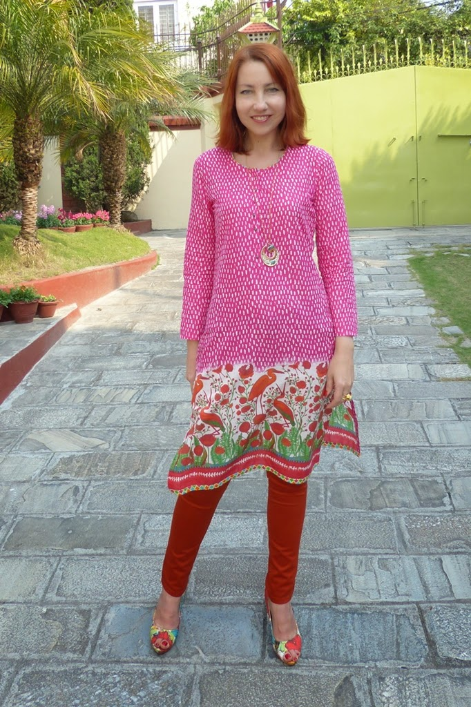 Indian Biba printed tunic worn over orange skinnies
