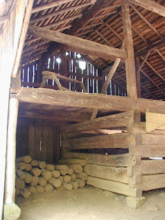 Somewhat typical interior structure of a barn.