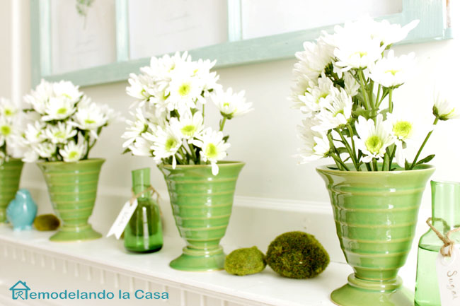 green vases with white flowers