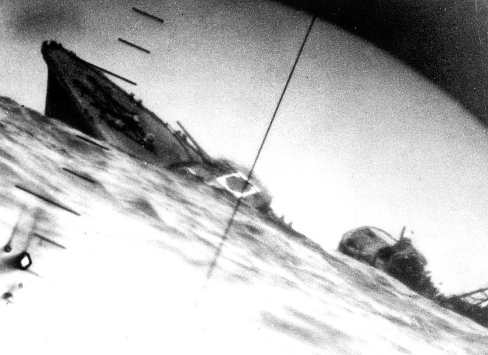 Torpedoed Japanese destroyer Yamakaze, photographed through periscope of USS Nautilus, 25 June 1942. The Yamakaze sank within five minutes of being struck, there were no survivors.