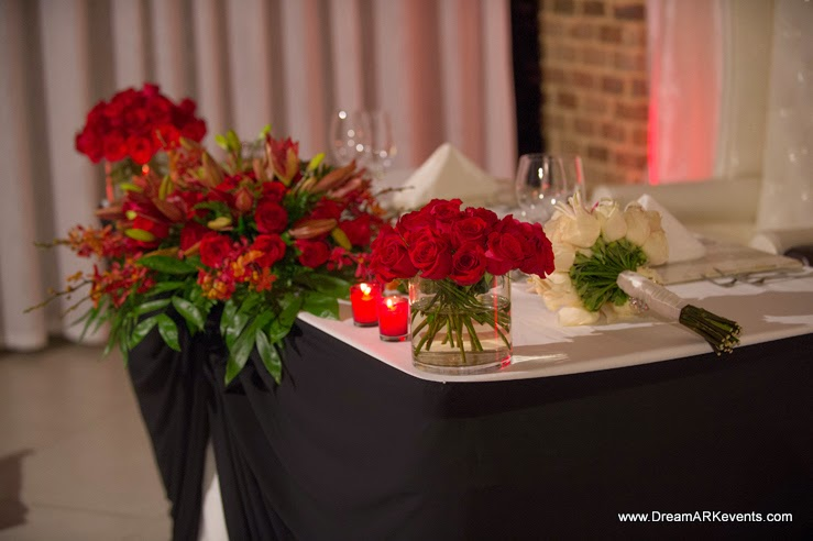 Wedding reception, main table flower centerpiece, back wall drape