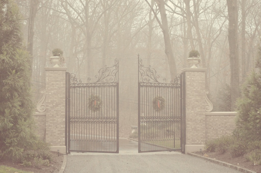Iron gates at entrance of Enchanted Home blogger Tina's French chateau