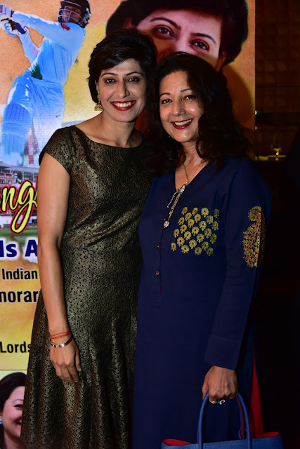 Hosts of the evening Anjum Chopra, woman cricketer, being congratulated by Neelam Pratap Rudy