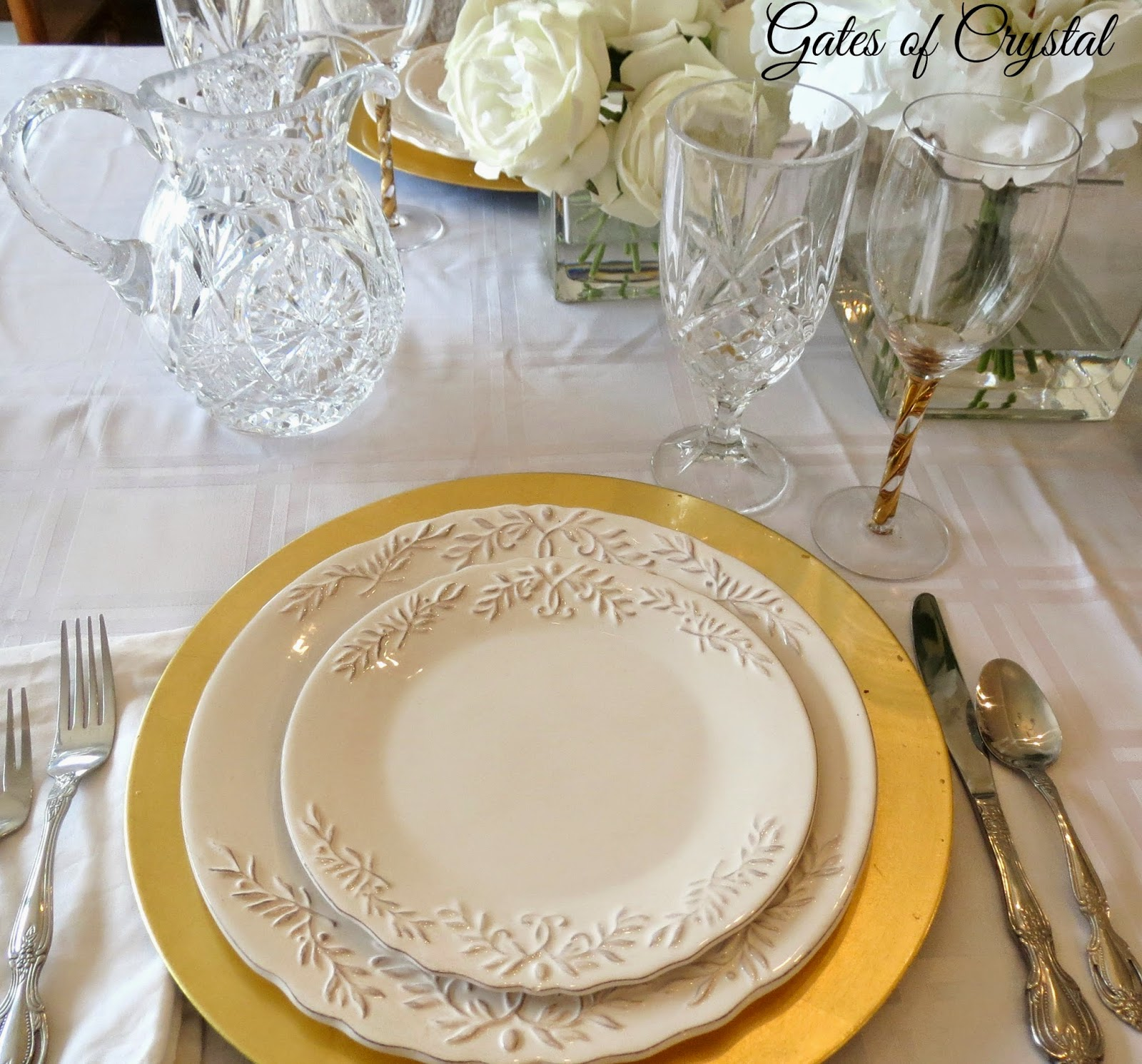 gates of crystal white and gold table setting. Black Bedroom Furniture Sets. Home Design Ideas