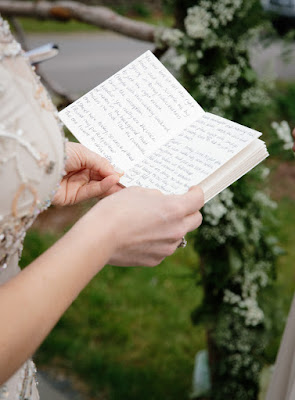 Reading handwritten vows during the outdoor ceremony for Jonna and Heather's Inn at West Settlement Wedding by Karen Hill Photography