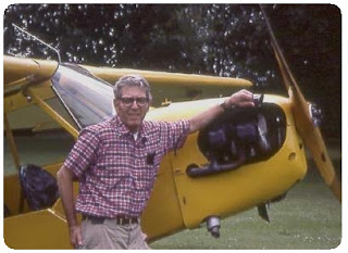 Photo of Frank B. Baker and his J-3 Piper Cub