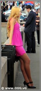 Sexy blonde girl in pink mini-dress
