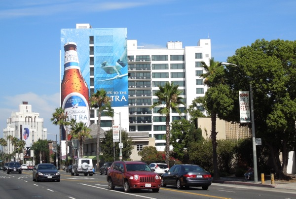 Giant Michelob Ultra surfer billboard