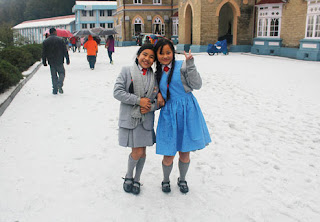 Girls in the ice-covered courtyard of Loreto Convent