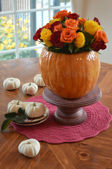 Pumpkin Vase Floral Arrangement on table with white baby pumpkins