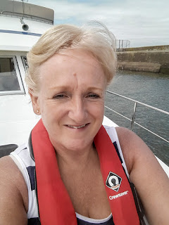 Photo of me on the boat on the way back