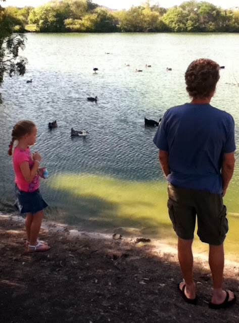 Wordless Wednesday - dad and daughter feeding the ducks image