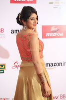 Harshika Ponnacha in orange blouuse brown skirt at Mirchi Music Awards South 2017 ~  Exclusive Celebrities Galleries 020.JPG