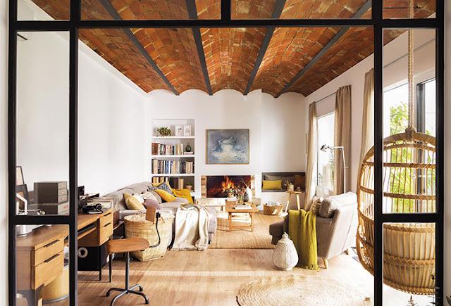 Accente rustice și tonuri naturale de culoare într-un apartament din Barcelona
