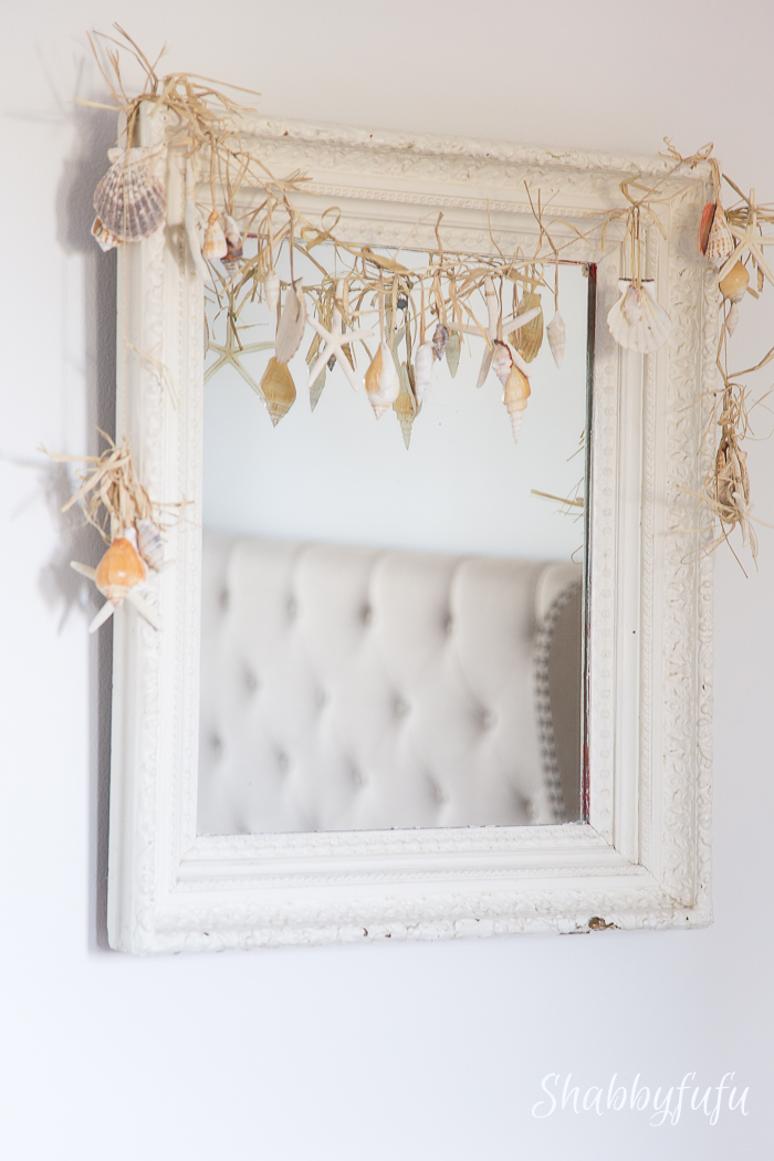 seashell garland on a mirror