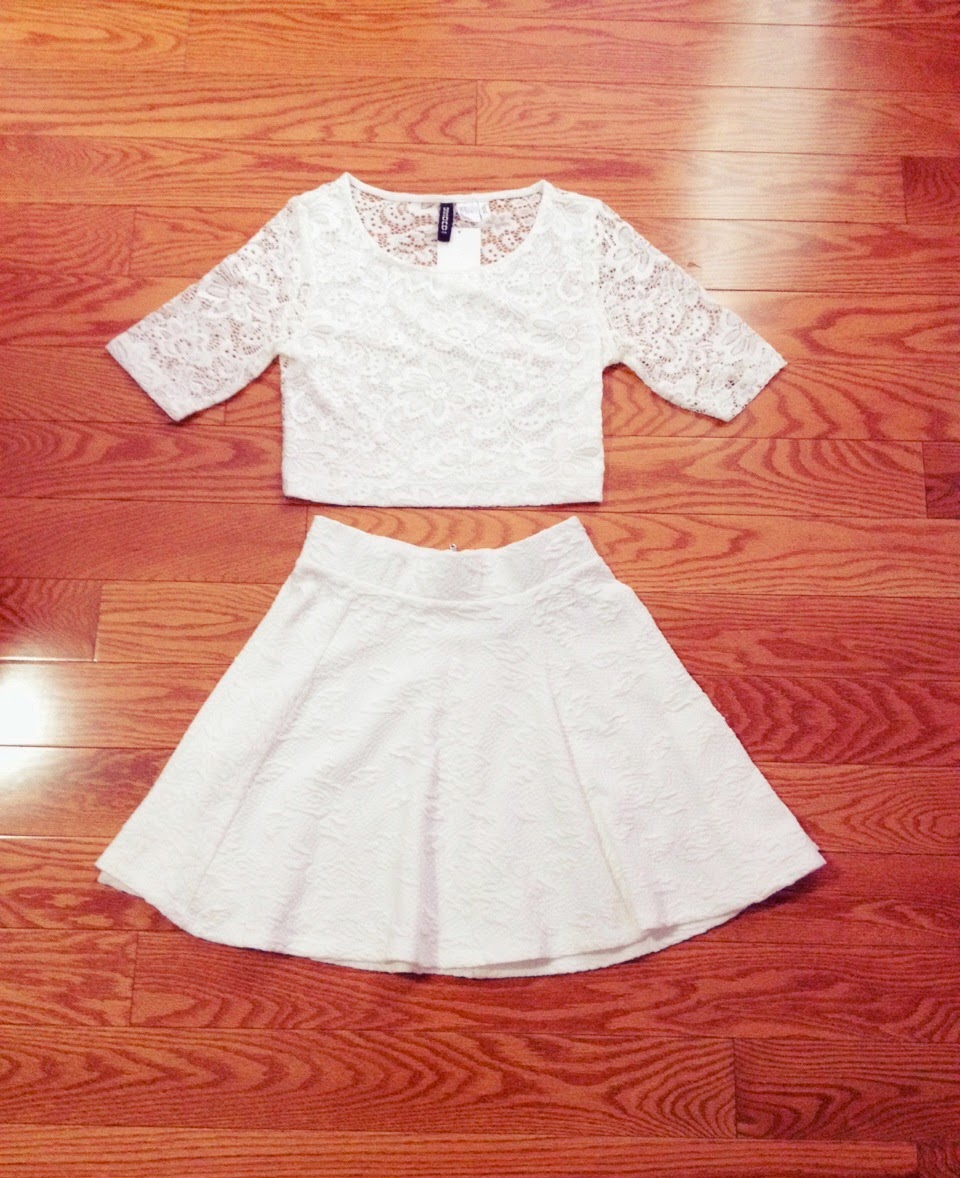 5e7f0b2452d9fc I also picked up a rose pattern print white skirt that goes well with the white  flowers lace crop top that I got.