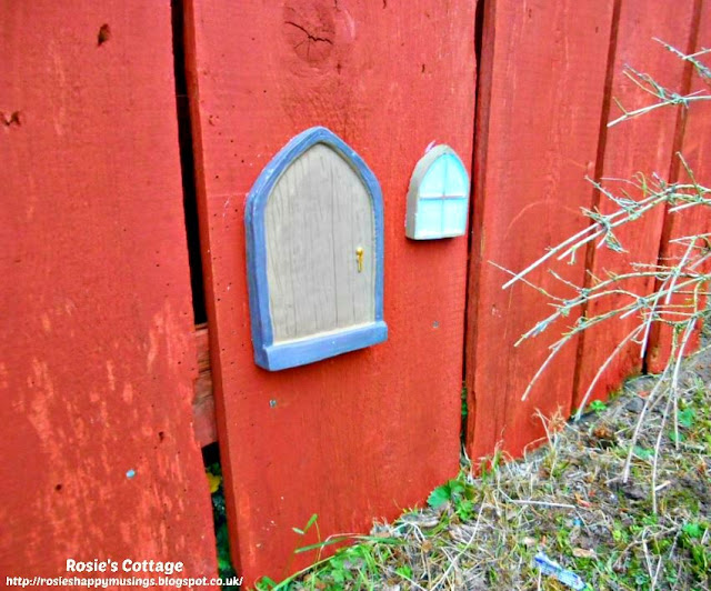 The little fairy door and window are fixed in place on the garden fence in the front garden.