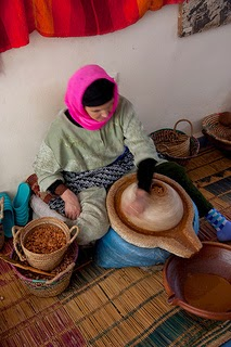 Grinding Argan Seeds Photo by tomaszd
