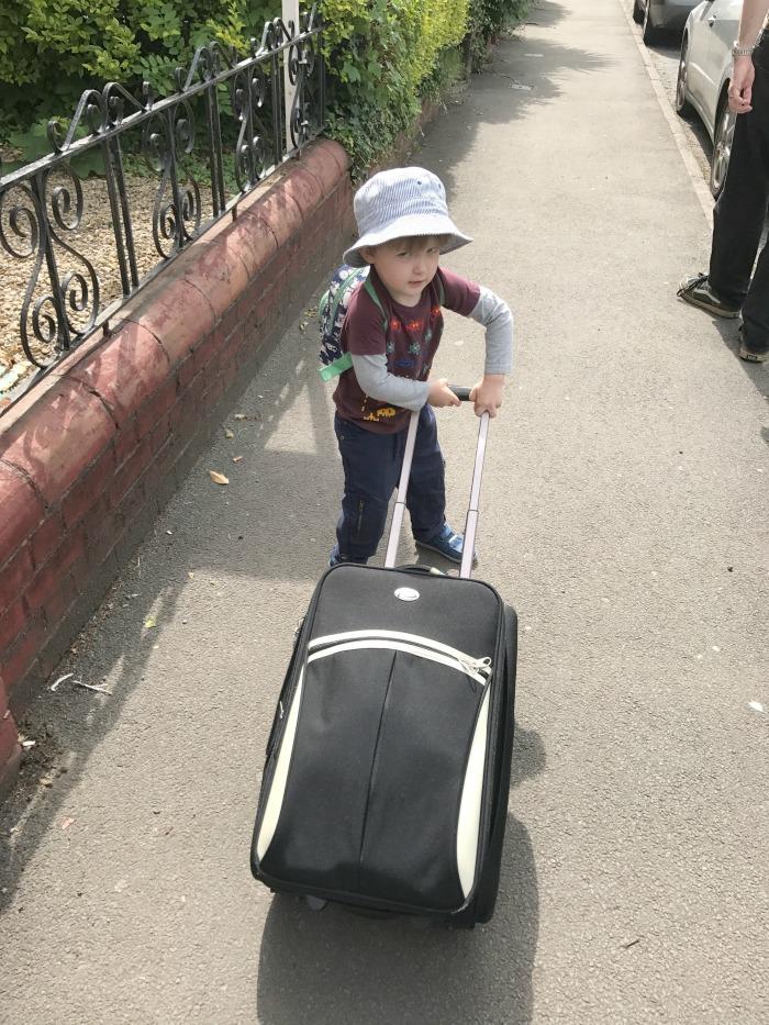 Squidge pulling a suitcase