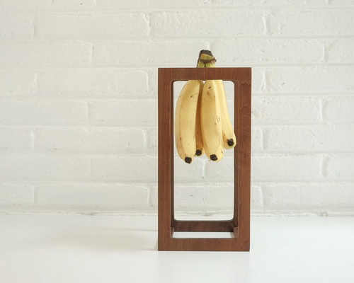 Tinuku.com Undhagi studio designed dessert banana holder using premium teak wood as well dining table décor