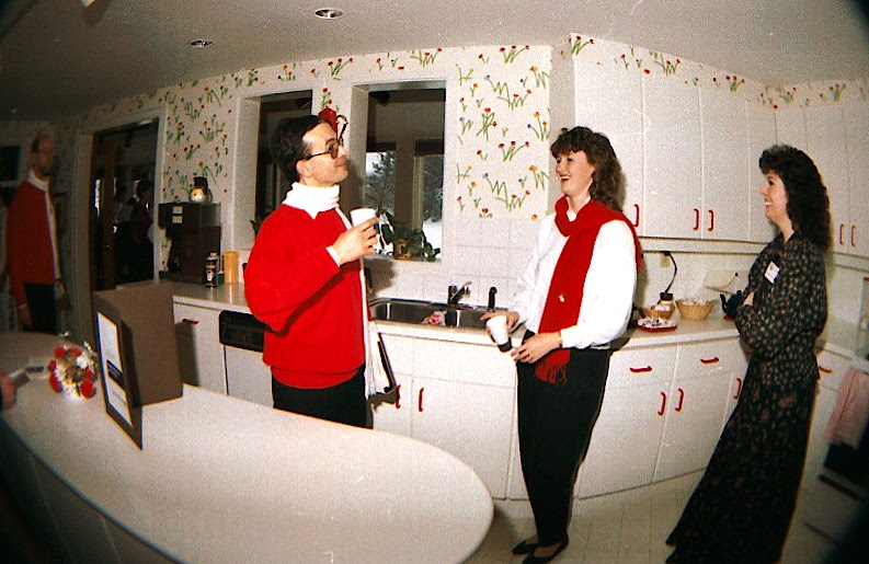 The Stairwell Carollers relax in the kitchen at Ronald McDonald House 1986
