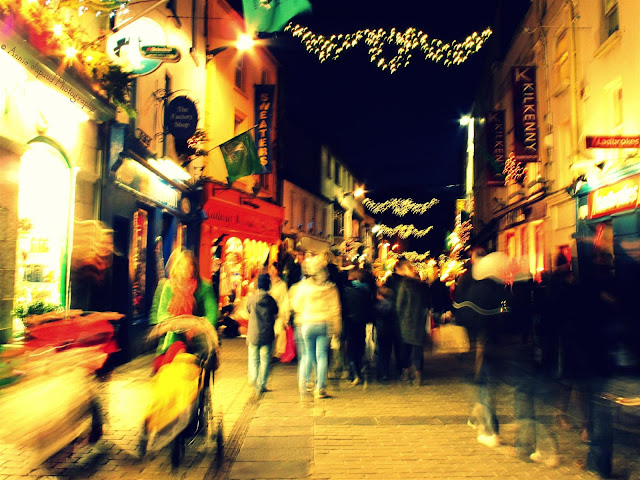 abstract image of people walking down Shop street, Galway