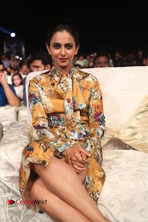 Actress Rakul Preet Singh Stills in Short Dress at Dhruva Pre Release Function  0095.JPG
