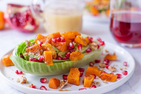 healthy superfood dinner salad with squash pomegranates