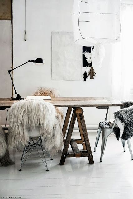 Layer your dining chairs with faux fur for more comfortable seating
