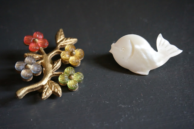 floral brooch and mother of pearl fish brooch