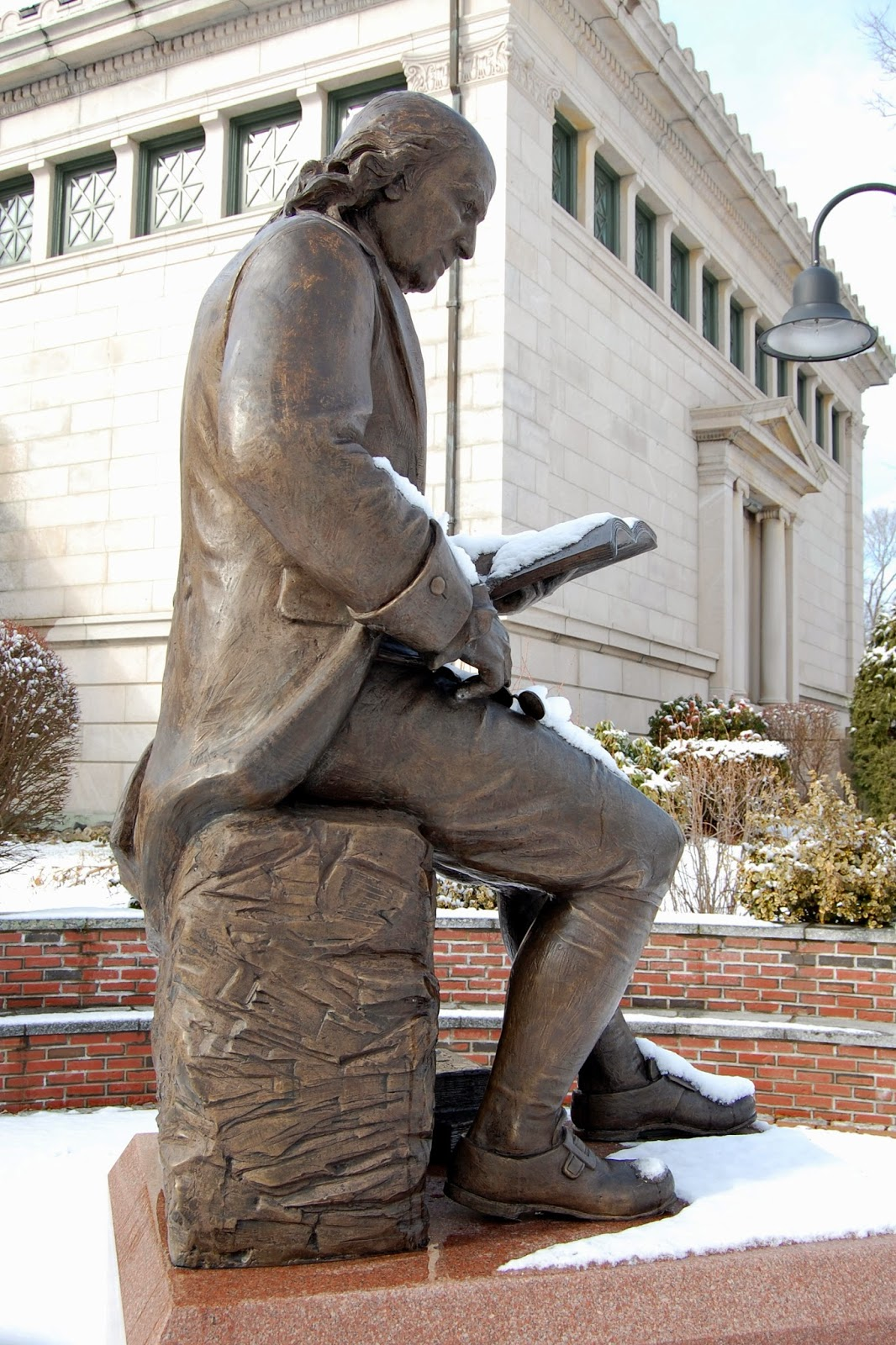 Ben Franklin reading outside the Franklin Library