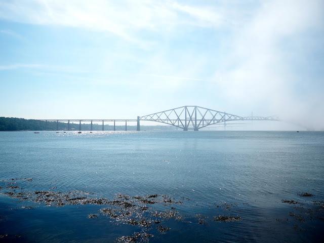 View of Forth Bridge from Dalmeny Estate Shore Walk in north Edinburgh
