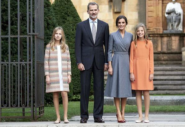 Queen Letizia wore grey coat dress, Crown Princess Leonor wore a Mango pattern jacket and Infanta Sofía wore a coral Mango dress