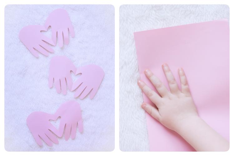Suloiset sydänkortit lapsen käden kuvasta