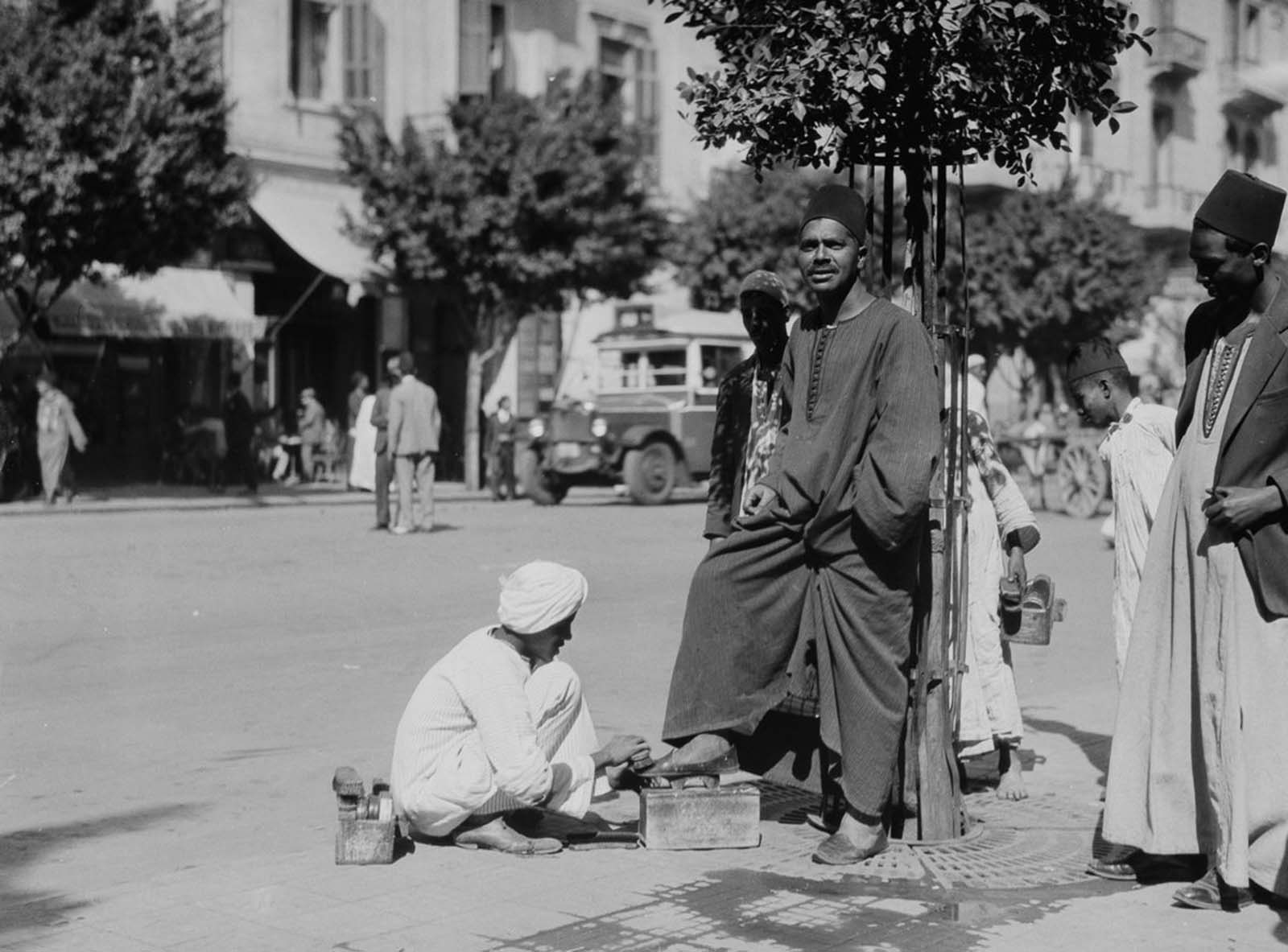 A man gets his shoes shined. 1934.
