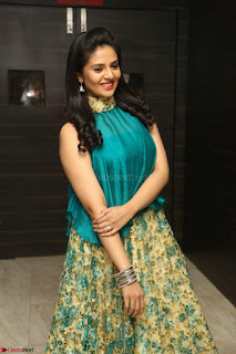 Anchor Srimukhi in green sleeveless top and skirt at O Pilla Nee Valla Movie Audio Launch Feb 2017 014.JPG