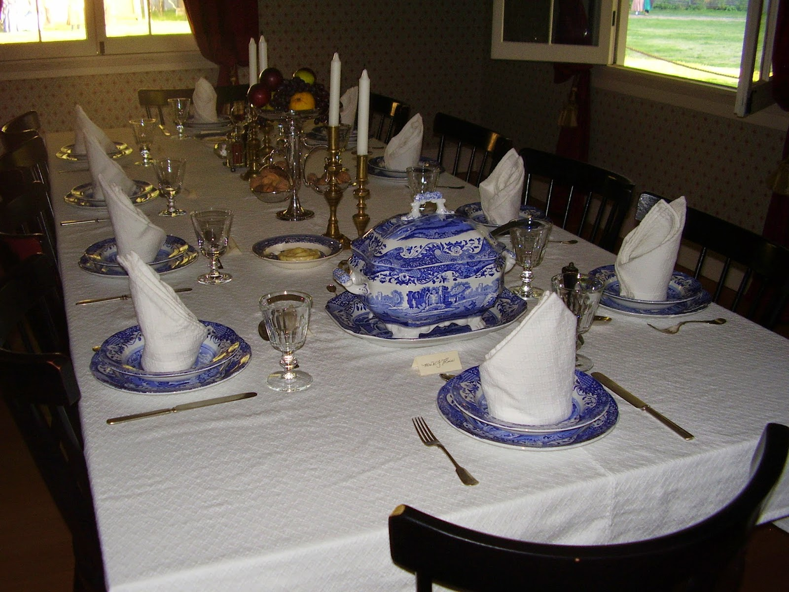 Long table set for 10 with Spode Blue Italian dishes.